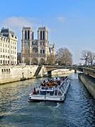 BERNARD JAUBERT - Cathedral Notre-Dame de Paris and pleasure boat on the Seine river. Paris. France