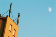 Cellular Phone Antennas And A Half Moon At Sunset Print by Sami Sarkis
