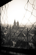 German Culture Prints - Chain Link Fence With Church Print by Boston Thek Imagery