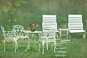 Garden Chair Framed Prints - Chairs And Table Set In The Garden. Sun Framed Print by Lawren Lu