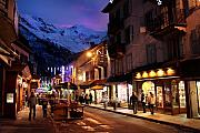 Ski Village Framed Prints - Chamonix town in the shadow of Mont Blanc in the French Alps Framed Print by Pierre Leclerc