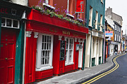 Facades Photo Posters - Charming Narrow Street in Kinsale Poster by George Oze