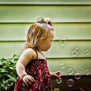Little Girl Photos - Chasing Bubbles by Matt Dobson