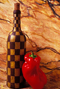 Containers Posters - Checker wine bottle and red pepper Poster by Garry Gay