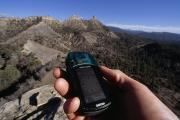 Reading Of Image Prints - Checking The Gps At Chimney Rock Print by Bill Hatcher