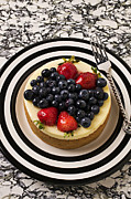 Cakes Posters - Cheese cake on black and white plate Poster by Garry Gay