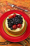 Blueberries Posters - Cheesecake on red plate Poster by Garry Gay