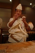 Peoples Republic Of China Photos - Chef Twirls Dough As He Makes Fresh by Richard Nowitz