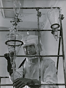 Laboratories Prints - Chemist In Protective Gear Working Print by Volkmar Wentzel