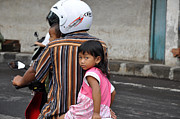 Girl On Bike Framed Prints - Child Of Bali Framed Print by Kamel Rekouane