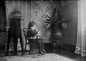 Lewis Wickes Hine Prints - Child Putting A Campbell Kid To Sleep Print by Everett