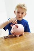 Money Posters - Child With A Piggy Bank Poster by Ian Boddy