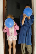 Bathrobe Photos - Children blowing up balloons by Sami Sarkis