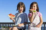 Watermelon Posters - Children Eating Watermelon Poster by Lawrence Lawry