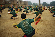 Peoples Republic Of China Photos - Children Practice Kung Fu In A Field by Justin Guariglia