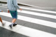 Crosswalks Prints - Children walking across a zebra crossing on a city street Print by Sami Sarkis