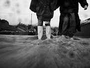 Floods Metal Prints - Children Walking In Heavy Rain Storm In The Street Metal Print by Joe Fox