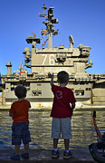 Ronald Reagan Photo Prints - Children Wave As Uss Ronald Reagan Print by Stocktrek Images