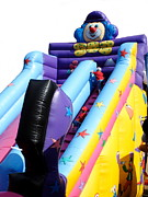 Slide Photographs Prints - Childrens Bouncy Slide Print by Lynne Dymond