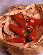Wooden Bowl Prints - Chilli Peppers in Bag Print by Jerry Taliaferro