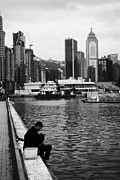 Poor People Prints - Chinese Man Fishing With Line On Hong Kong Waterfront Hksar China Print by Joe Fox