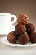 Saucer Prints - Chocolate truffles and coffee Print by Elena Elisseeva