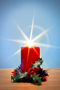 Starburst Prints - Christmas candle with starburst and holly. Print by Richard Thomas