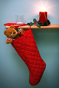 Red Flame Framed Prints - Christmas stocking filled with presents with empty milk glass.  Framed Print by Richard Thomas