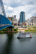 Riverboat Framed Prints - Cincinnati Skyline Riverboat and Bridge Framed Print by Paul Velgos