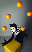 Comedian Framed Prints - Circus fashion mime juggles with five oranges. Photo. Framed Print by Kireev Art