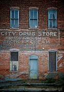 Groceries Photo Posters - City Drug Store Poster by Odd Jeppesen