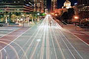 Light Trail Posters - City Light Trails On Street In Downtown Poster by Eric Lo