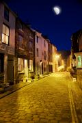 Moonlit Night Framed Prints - City Street At Night, Staithes Framed Print by John Short