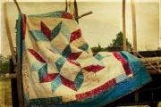 Quilt Photo Posters - Claudes Centennial Quilt Poster by Toni Hopper