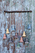 Doorbell Framed Prints - Clay Bells on a Weathered Door Framed Print by Jeremy Woodhouse