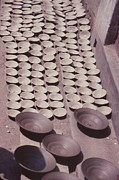 Hand Thrown Pottery Photo Prints - Clay Yogurt Cups Drying In The Sun Print by David Sherman
