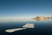 Ice Floes Art - Clear Sky Over Ice Floes In The Water by Norbert Rosing