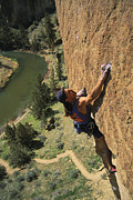 River Scenes Posters - Climber On Smith Rock Above The Crooked Poster by Mark Cosslett