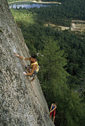 Ledge Photo Posters - Climbers Inch Up A 600-foot Climb Poster by Phil Schermeister