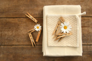 Daisy Framed Prints - Close-pins and dish towels on old table  Framed Print by Sandra Cunningham