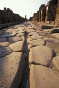 Ruins Photos - Close Up Of A Chariot Rut In Ancient by Richard Nowitz