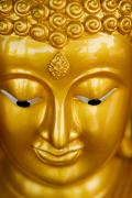 Religious Art Photos - Close-up of a golden Buddha by Ray Laskowitz - Printscapes