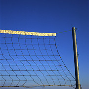 Leisure Activity Prints - Close-up of a volleyball net abandoned. Print by Bernard Jaubert