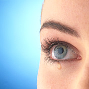 Tear Drop Posters - Close-up Of A Womans Blue Eye With A Tear-drop Poster by Phil Jude