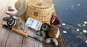 Freshwater Posters - Close-up of fishing equipment and hat  Poster by Sandra Cunningham
