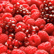 Large Group Of Objects Art - Close Up Of Fresh Raspberries And Pomegranate by Andrew Bret Wallis