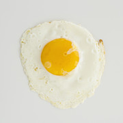 Sunny Side Up Framed Prints - Close Up Of Fried Egg, Studio Shot Framed Print by Jamie Grill