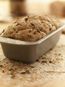 Loaf Of Bread Photo Prints - Close Up Of Rustic Bread In Loaf Pan Print by Adam Gault
