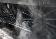 Steam And Smoke Prints - Close-up Of Steam Engine Train Wheels Print by John Short