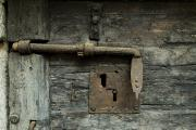 Crimes Prints - Close View Of A Lock On A Door Print by Todd Gipstein